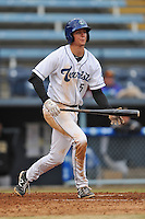 Asheville Tourists third baseman Ryan McMahon #5 swings at a pitch during game one of a double header against the West Virginia Power at McCormick Field on April 8, 2014 in Asheville, North Carolina. The Power defeated the Tourists 6-5. (Tony Farlow/Four Seam Images)