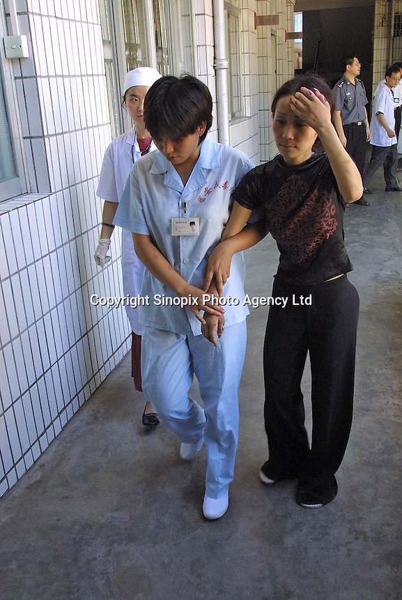 Ah Li, a 21 year-old female drug addict led to a drug rehabilitation centre in Bao'an, China.  Ah Li moved to Shenzhen from northern China when just sixteen years old after the break-up of her family. She was tricked into prostitution and initially forced to take drugs until she became addicted and dependent on her gang bosses.