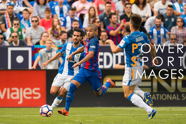 Rafinha of FC Barcelona battles for the ball with Pablo Insua of Deportivo Leganes during their La Liga match between Deportivo Leganes and FC Barcelona at the Butarque Municipal Stadium on 17 September 2016 in Madrid, Spain. Photo by Diego Gonzalez Souto / Power Sport Images