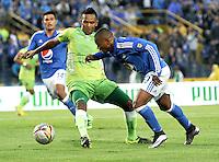 BOGOTA - COLOMBIA -21 - 02 - 2016: Andres Escobar (Der.) jugador de Millonarios disputa el balón con Leonardo Escorcia (Izq.) jugador de Jaguares FC, durante partido de la fecha 5 entre Millonarios y Jaguares FC, de la Liga Aguila I-2016, jugado en el estadio Nemesio Camacho El Campin de la ciudad de Bogota.   / Andres Escobar (R) player of Millonarios vies for the ball with Leonardo Escorcia (L) player of Jaguares FC, during a match between Millonarios and Jaguares FC, for the date 5 of the Liga Aguila I-2016 at the Nemesio Camacho El Campin Stadium in Bogota city, Photo: VizzorImage / Luis Ramirez / Staff.