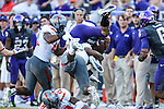 TCU Horned Frogs wide receiver Cameron Echols-Luper (15) and Texas Tech Red Raiders running back Kenny Williams (34) in action during the game between the Texas Tech Red Raiders and the TCU Horned Frogs at the Amon G. Carter Stadium in Fort Worth, Texas. TCU defeats Texas Tech 82 to 27.