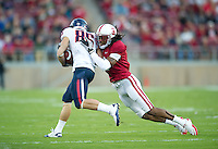STANFORD, CA - November 6, 2010: Richard Sherman tackles during a 42-17 Stanford win over the University of Arizona, in Stanford, California.