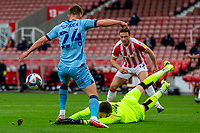 21st April 2021; Bet365 Stadium, Stoke, Staffordshire, England; English Football League Championship Football, Stoke City versus Coventry; Goalkeeper Angus Gunn of Stoke City makes a diving save at the feet of Matt Godden of Coventry City