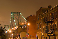 AVAILABLE FROM JEFF AS A FINE ART PRINT.<br /> <br /> AVAILABLE FROM PLAINPICTURE FOR COMMERCIAL AND EDITORIAL LICENSING.  Please go to www.plainpicture.com and search for image # p5690106.<br /> <br /> Street Scene at Night in the Williamsburg Neighborhood of Brooklyn, Williamsburg Bridge in the background, New York City, New York City, USA