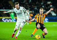 Hull City's midfielder Seb Larsson (16) stops Sheffield United's midfielder Lee Evans (20) during the Sky Bet Championship match between Hull City and Sheff United at the KC Stadium, Kingston upon Hull, England on 23 February 2018. Photo by Stephen Buckley / PRiME Media Images.