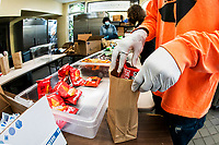 NEW YORK, NY - NOVEMBER 23:  Volunteers organize food to be distribute to residents as the global outbreak of the coronavirus disease (COVID-19) continues increase on November 23, 2020 in New York. Novel coronavirus have surpassed 12.5 million with more than 262,000 deaths in U.S. given a mortality rate of  3.5%. (Photo by Eduardo MunozAlvarez/VIEWpress)
