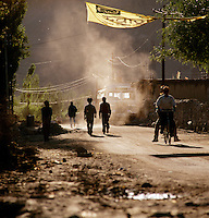 Street scene with men and bicycle, Leh, Ladakh, India