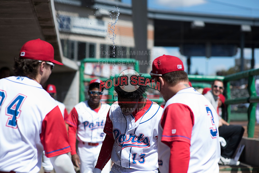 Stockton Ports left fielder Lazaro Armenteros (13) is congratulated by teammates after hitting a home run during a California League game against the San Jose Giants on April 9, 2019 in Stockton, California. San Jose defeated Stockton 4-3. (Zachary Lucy/Four Seam Images)
