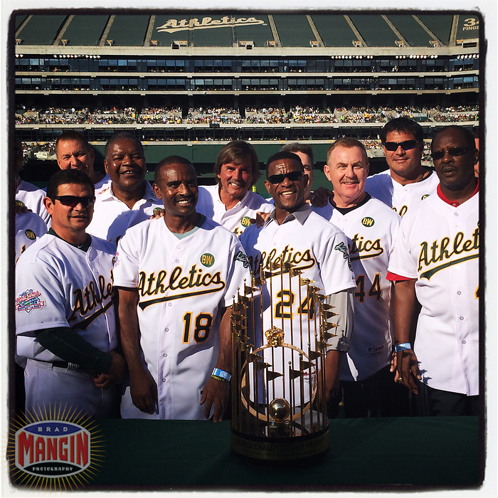 OAKLAND, CA - JULY 19: iPhone Instagram of Mike Gallego, Tony Phillips, Dave Henderson, Dennis Eckersley, Rickey Henderson, and Jose Canseco of the 1989 World Series champion Oakland Athletics pose with the World Series trophy at a team reunion before a game at the Oakland Coliseum on July 19, 2014 in Oakland, California. (Photo by Brad Mangin)