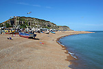 Great Britain, England, East Sussex, Hastings: View along  pebble beach The Stade with drawn up fishing boats