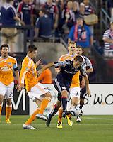 New England Revolution midfielder Marko Perovic (29) dribbles in a crowd. The New England Revolution defeated Houston Dynamo, 1-0, at Gillette Stadium on August 14, 2010.