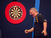 21.12.2014.  London, England.  William Hill World Darts Championship.  Wayne Jones [ENG] celebrates a finish during his game with Dean Winstanley (26) [ENG]. Winstanley won the match 3-2