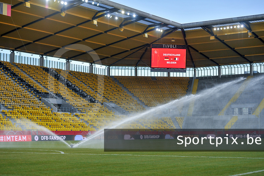 spraying the grass before a friendly female soccer game between the national teams of Germany and  Belgium , called the Red Flames  in a pre - bid tournament called Three Nations One Goal with the national teams from Belgium , The Netherlands and Germany towards a bid for the hosting of the 2027 FIFA Women's World Cup , on Sunday 21 st of February 2021  in Aachen , Germany . PHOTO SPORTPIX.BE | SPP | STIJN AUDOOREN