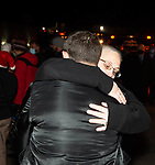 WATERTOWN, CT-122320JS17- Moses Don of Waterbury, a friend of 28-year-old Nathan Daniel Burk, gets a hug from a supporter during a vigil for Burk near the UPS facility in Watertown on Wednesday. Burk was killed by a co-worker earlier in the day. <br /> Jim Shannon Republican-American