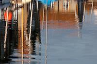 Blakeney, Norfolk, England, 03/08/2009..Boats in Blakeney harbour in the early morning.