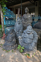 Yogyakarta, Java, Indonesia.  Contrasting Buddhas, Chinese (foreground) and Javanese Style.