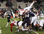 Fresno State's Robbie Rouse (8) jumps over Nevada's defensive line to score during the second half of an NCAA college football game in Reno, Nev., on Saturday, Nov. 10, 2012. (AP Photo/Cathleen Allison)