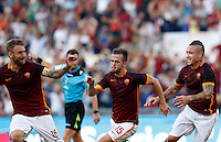 Calcio, Serie A: Roma vs Juventus. Roma, stadio Olimpico, 30 agosto 2015.<br /> Roma's Miralem Pjanic, center, celebrates with teammates Daniele De Rossi, left, and Radja Nainggolan, after scoring during the Italian Serie A football match between Roma and Juventus at Rome's Olympic stadium, 30 August 2015.<br /> UPDATE IMAGES PRESS/Riccardo De Luca
