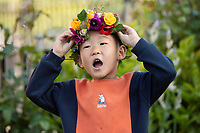 BNPS.co.uk (01202 558833)<br /> Pic: ZacharyCulpin/BNPS<br /> <br /> Pictured: Charlie Yan, 4 with his flower crown created as part of Garden Day<br /> <br /> Londoners celebrate Garden Day by making flower crowns in the gardens of St George the Martyr church in Southwark.  <br /> <br /> Garden Day is back for a third successive year on Sunday, 9th May 2021 to celebrate outdoor and indoor garden spaces. The nationwide movement is called on plant-lovers to make a flower crown, and share their plant spaces with family and<br /> friends