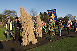 Straw Bear Festival. Whittlesea Whittlesey Cambridgeshire UK 2008. Straw Bear and handler. Children Bear and German Straw Bear follow procession around the town.