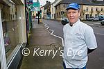 Local butcher John Burke, standing outside his shop in Milltown.