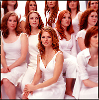 Group of red haired women wearing white clothes<br />