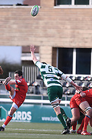 20th February 2021; Trailfinders Sports Club, London, England; Trailfinders Challenge Cup Rugby, Ealing Trailfinders versus Doncaster Knights; James Mitchell of Doncaster Knights kicks from the base of the ruck under pressure from James Cannon of Ealing Trailfinders