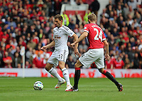 Pictured L-R: Angel Rangel of Swansea against Darren Fletcher of Manchester United. Saturday 16 August 2014<br /> Re: Premier League Manchester United v Swansea City FC at the Old Trafford, Manchester, UK.
