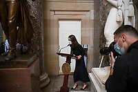 A woman wheels the lectern of Speaker of the United States House of Representatives Nancy Pelosi (Democrat of California) through Statuary Hall at the U.S. Capitol, as the House of Representatives debate on H. Res. 24, Impeaching Donald John Trump, President of the United States, for high crimes and misdemeanors, at the U.S. Capitol in Washington, DC, Wednesday, January 13, 2021. Credit: Rod Lamkey / CNP /MediaPunch