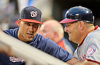 24 July 2012: Washington Nationals shortstop Ian Desmond, currently on the DL, has words with first base coach Trent Jewett during a game against the New York Mets at Citi Field in Flushing, NY. The Nationals defeated the Mets 5-2 to take the second game of their 3-game series. Mandatory Credit: Ed Wolfstein Photo