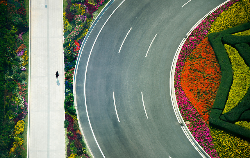 A person walks along a footpath outside the Fortune Global Forum in Guangzhou, China on Wednesday, Dec. 6, 2017.  THE CANADIAN PRESS/Sean Kilpatrick