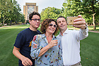 August 19, 2016; First year student Edoardo Bianchi, and his parents Franco and Alessandra take a selfie on the library quad during Welcome Weekend 2016. (Photo by Matt Cashore/University of Notre Dame)