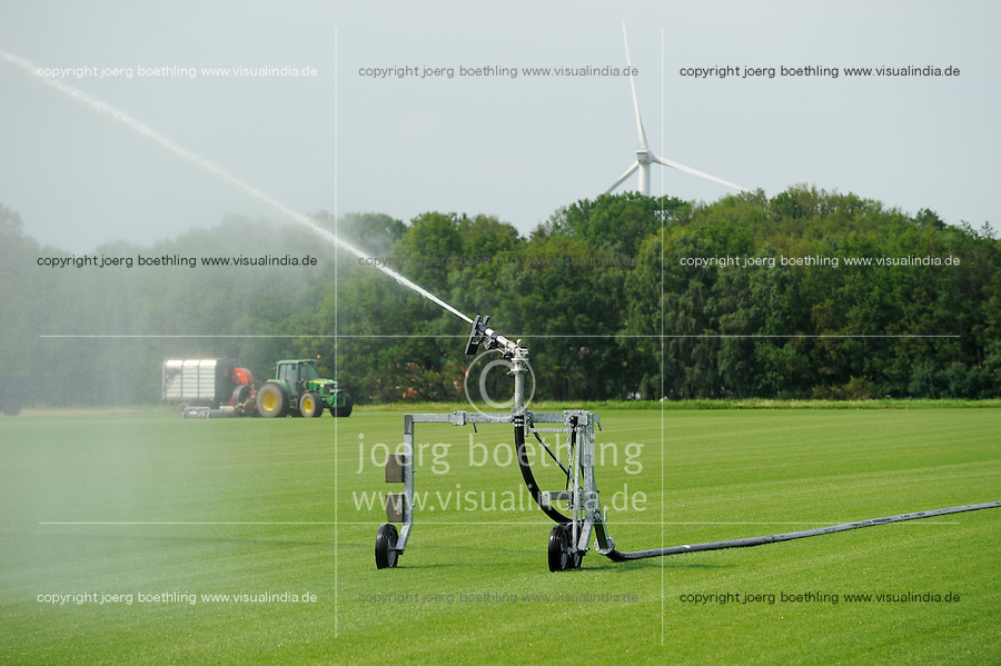 GERMANY, irrigation of rolling lawn field