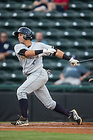 Vicente Conde (4) of the Charleston RiverDogs follows through on his swing against the Hickory Crawdads at L.P. Frans Stadium on August 25, 2015 in Hickory, North Carolina.  The Crawdads defeated the RiverDogs 7-4.  (Brian Westerholt/Four Seam Images)