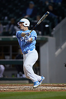 Brendan Illies (43) of the North Carolina Tar Heels follows through on his swing against the Charlotte 49ers at BB&T BallPark on March 27, 2018 in Charlotte, North Carolina. The Tar Heels defeated the 49ers 14-2. (Brian Westerholt/Four Seam Images)