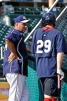 Brooklyn Cyclones hitting coach Benny DiStefano (24) talks with Jet Butler (29) before game against the Aberdeen Ironbirds at MCU Park in Brooklyn, NY June 21, 2010. Cyclones won 5-2.  Photo By Tomasso DeRosa/Four Seam Images