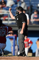 Umpire Dave Albertson makes a call during a game between the Lowell Spinners and Batavia Muckdogs on July 16, 2014 at Dwyer Stadium in Batavia, New York.  Lowell defeated Batavia 6-4.  (Mike Janes/Four Seam Images)