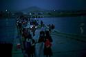 Iraq 2014  <br /> August 10, Yezidis  crossing the bridge of Pesh Kabur by night  <br /> Irak  2014  <br /> Yezidis traversant la nuit le pont de Pesh Kabur. Sur la rive irakienne, des vehicules vont les transporter vers un camp de transition.