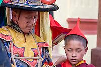 Nepal, Kathmandu, Swayambhunath.  Senior Tibetan Buddhist Monk and Young Boy.