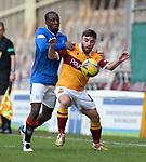 17.01.2021 Motherwell v Rangers: Glen Kamara and Steven Lawless