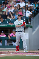 Travis Snider (26) of the Gwinnett Stripers checks his bat before stepping up to the plate during the game against the Charlotte Knights at Truist Field on July 17, 2021 in Charlotte, North Carolina. (Brian Westerholt/Four Seam Images)