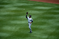 OAKLAND, CA:  Ken Griffey Jr. of the Seattle Mariners catches a fly ball in center field during a game against the Oakland Athletics at the Oakland Coliseum in Oakland, California on May 11, 1995. (Photo by Brad Mangin)