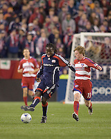 New England Revolution midfielder Shalrie Joseph (21) passes as FC Dallas midfielder Dax McCarty (13) closes. The New England Revolution defeated FC Dallas, 2-1, at Gillette Stadium on April 4, 2009. Photo by Andrew Katsampes /isiphotos.com