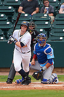 Montgomery Biscuits first baseman Cameron Seitzer (33) at bat in front of catcher Kyle Schwarber and umpire Alex Ransom during a game against the Tennessee Smokies on May 25, 2015 at Riverwalk Stadium in Montgomery, Alabama.  Tennessee defeated Montgomery 6-3 as the game was called after eight innings due to rain.  (Mike Janes/Four Seam Images)