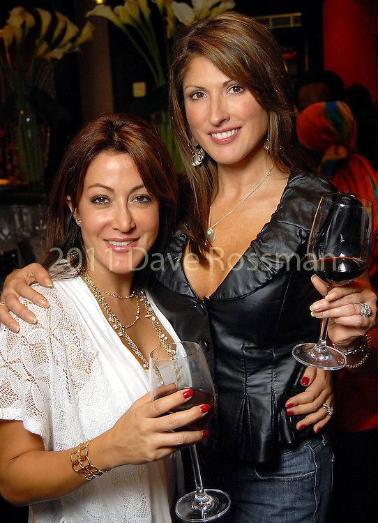 Suly Weissman and Nellie Gonzalez at the grand opening of the Valentino restaurant at the Hotel Derek Thursday Oct. 15,2009. (Dave Rossman/For the Chronicle)