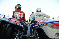 Jul. 1, 2012; Joliet, IL, USA: NHRA pro stock motorcycle rider Hector Arana Jr (right) alongside father Hector Arana Sr during the Route 66 Nationals at Route 66 Raceway. Mandatory Credit: Mark J. Rebilas-