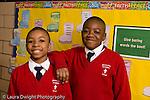 K-8 Parochial School Bronx New York Grade 4 portrait of two boys in hallway horizontal