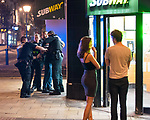 © Joel Goodman - 07973 332324. 26/09/2017. Brighton, UK. Police detain and handcuff a man outside a branch of Subway after a fight in Steine Gardens in the Kemptown area of the city . Revellers at the end of a night out in Brighton during Freshers week , when university students traditionally enjoy the bars and clubs during their first nights out in a new city . Photo credit : Joel Goodman