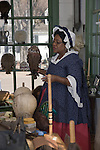 A woman portrays a colonial wigmaker in the Barber & Peruke Shop at Colonial Williamsburg, Virginia.