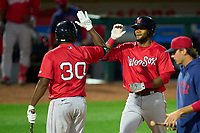 Worcester Red Sox Franchy Cordero (37) high fives Josh Ockimey (30) after hitting a home run during a game against the Rochester Red Wings on September 2, 2021 at Frontier Field in Rochester, New York.  (Mike Janes/Four Seam Images)